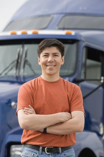 Direct hire worker standing near OTR semi truck