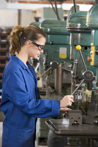 Temporary worker at factory drill press